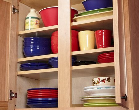 <b>More space for plates and bowls</b></br> <p>Most cabinets   come with only   one or two   shelves, leaving a   lot of wasted   space. So I added   one (and sometimes   two)   shelves to most of   my cabinets. All it   takes is 3/4-in.   plywood and a   bag of shelf supports.   The supports   come in two   diameters, so take   an existing one to   the store to make   sure you get the right size.</p>
