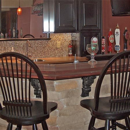"""<b>Finished basement centerpiece</b></br> Mike spent three years turning his unfinished basement into an entertainment space, complete with full bath, home theater and a shrine to the Cincinnati Reds.<br><br>  <div><img src='http://images.reimanpub.com/TFH/Step-By-Step/FH12SEP_BUIBAR_04x.JPG' alt='Mike Kinross' width='100' border='0' style='max-width: 150px; float: left; margin-right: 10px;' title='Michael Finfrock' /> <div style='margin-top: 0px; clear: both; font-style: italic; font-size: 10px; padding: 5px; width: 88px; float: left; margin-right:10px; border-left: 1pt solid #cccccc; border-right: 1pt solid #cccccc; border-bottom: 1pt solid #cccccc;'> Mike Kinross, DIYer<br /> Liberty Township, Ohio<br /></div></div>""""It strokes my ego when friends say: 'You did this yourself? Amazing!'"""""""