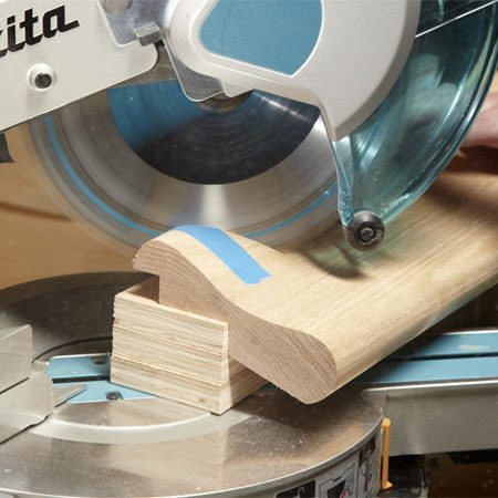 <b>Prop it up for miters</b></br> The underside of most bar molding tilts downward when installed. So you can't just lay it on the saw bed when you make angled cuts. Instead, set the molding on blocks to hold it at the correct tilt. (You can lay the molding flat to make 90-degree cuts, however.) Tape the molding to limit tear-out where the saw teeth exit the wood.
