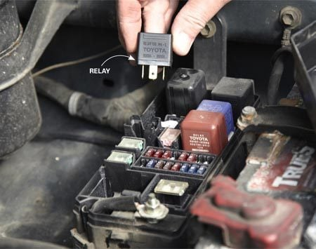 <b>Photo 3: Swap relays</b></br> Yank the fuel pump relay straight up. Then align the pins on the replacement relay and push it straight into the socket.