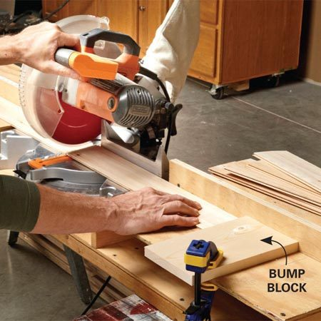 <b>Photo 5: Get identical lengths without measuring</b></br> Determine the exact length of the slats for each panel, then clamp down a bump block to cut them to identical lengths.