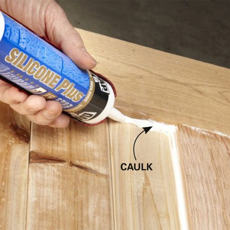 <b>Photo 8: Caulk the slats</b></br> Apply additional caulk where the slats butt into the rails and stiles.