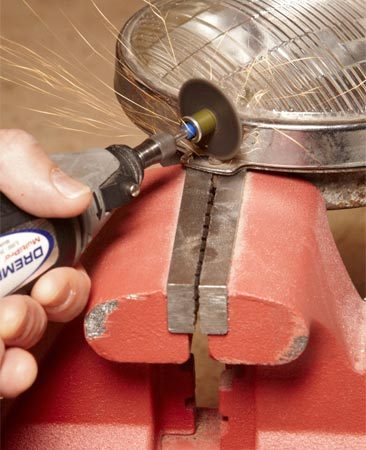 <b>Photo 3: Stripped out? Cut into the head</b></br> Slice a deep groove into the screw head with a cutting wheel and rotary tool. Make it wide enough to accommodate your largest flat-blade screwdriver.