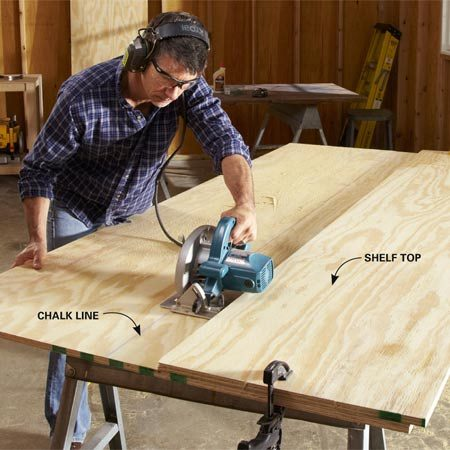 <b>Photo 1: Cut plywood parts perfectly straight</b></br> Cut the shelf top first and use the factory-cut edge as a guide for your other cuts. Measure the distance between the saw blade and the edge of the saw base plate, and align the shelf top that same distance away from your cutting line.