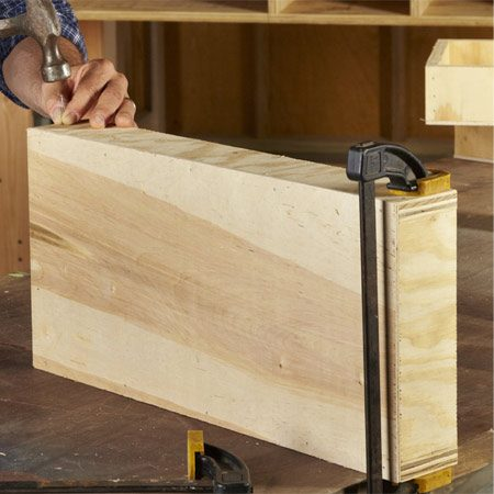 <b>Photo 7: Build simple drawers</b></br> Glue and clamp the front, back and sides together first. Then nail on the bottom. Finally, nail the sides to the front and back.