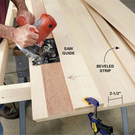 <b>Photo 1: Cut beveled strips</b></br> Start by positioning the beveled guide 1 in. from the edge and cutting a strip with a bevel on one edge. You can use this to make hangers. Then make a series of marks 2-1/2 in. apart on each end of the sheet. Line up the saw guide with the marks to cut the beveled strips.