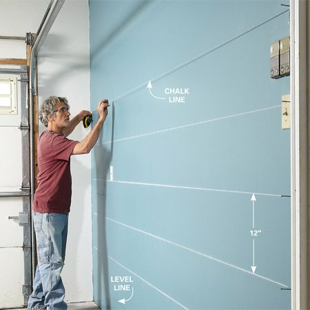 <b>Photo 3: Mark cleat locations with chalk lines</b></br> Measure up from the level line and make marks every 12 in. Do this on both ends. Then snap chalk lines between the marks. Use dust-off chalk, which won't leave permanent stains on the wall.