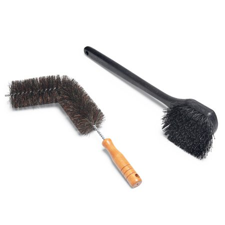 "<b>Photo 2: Get special brushes for the firebox</b></br> <p>Buy a bendable ""noodle brush""  to clean the smoke   shelf and a long-handled brush  to clean soot off the sides of the firebox.</p>"