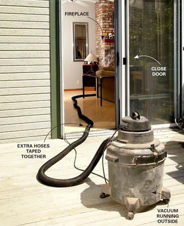 <b>Photo 4: Vent to the outdoors</b></br> Add sections to lengthen the vacuum hose, then connect it to your shop vacuum outside. Run the vacuum while you brush, and replace the filter when it clogs.