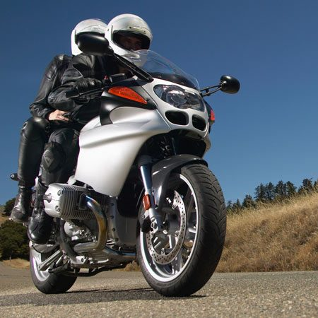 "<b>Passengers add weight</b></br> <p>And adding weight compresses your motorcycle's suspension. The amount of travel your suspension uses simply to support your bike and everything you pile onto it is called ""dynamic sag."" The more dynamic sag you have, the less suspension travel you have left to absorb stuff while you're riding.</p>  <p>You can decrease dynamic sag by increasing suspension-component spring preload levels. In other words, if you're going to carry a passenger (and/or anything else, like luggage), bump up the preload on your shock(s) and forks. Check your owner's manual; it'll give you suggested weight/preload settings. Super-cool bikes let you adjust compression and rebound damping, too.</p>"