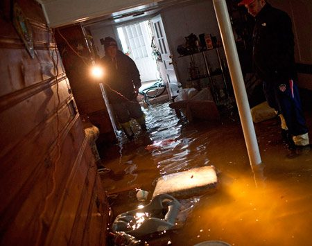 <b>Water and electricity </b><br/>The water in a flooded basement probably isn't electrified by your home's electrical lines. But it could be. So instead of finding out the hard way, just consider it an energized pool of instant death until you call your utility company to disconnect your power. Then you can dive in. And after the water is gone, remember that anything electrical in the basement may still be wet, damaged and dangerous. So it's best to leave the basement power off until your utility company or an electrician gives you the OK. <br/>Getty Images Photographer Andrew Burton/Stringer