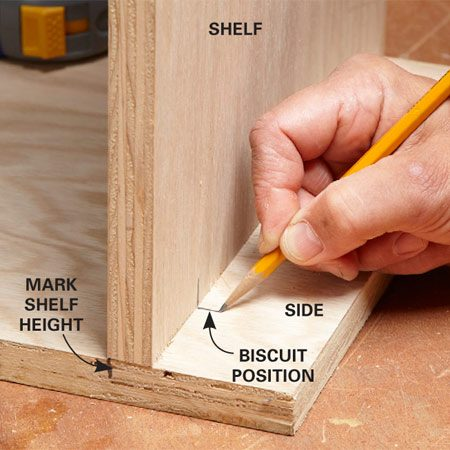 <b>Photo 1: Mark the biscuit</b></br> First, mark the height of the shelf on the cabinet side, then stand the shelf up and mark the location of the biscuit slots on both pieces.