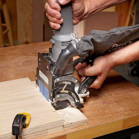 <b>Photo 3: Cut the side slots</b></br> Now flip the joiner upright and cut the matching slots in the sides.