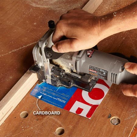 <b>Photo 10: Offset the joiner</b></br> When you cut slots in the edging, put thin cardboard or a few pieces of paper under the joiner.