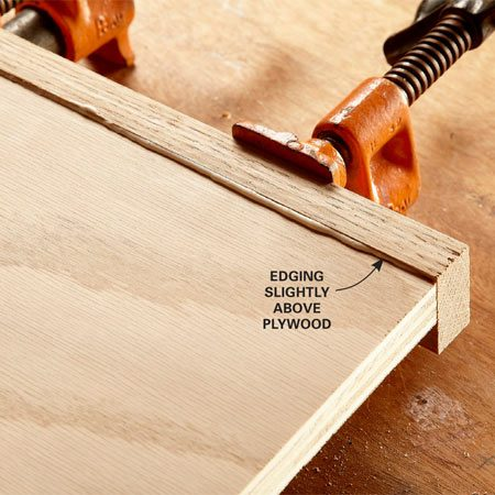 <b>Photo 11: Sand the edges flush</b></br> The edging will be slightly above the surface of the plywood when you glue it on. This gives you a small, safe amount to sand off without damaging the plywood.