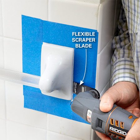 <b>To replace a towel bar, use an oscillating tool</b></br> Jam the blade into a corner about 1 in. deep. Then work it all around the fixture. Shove it in deeper and do a second pass around the fixture, cutting through all the adhesive and caulk.