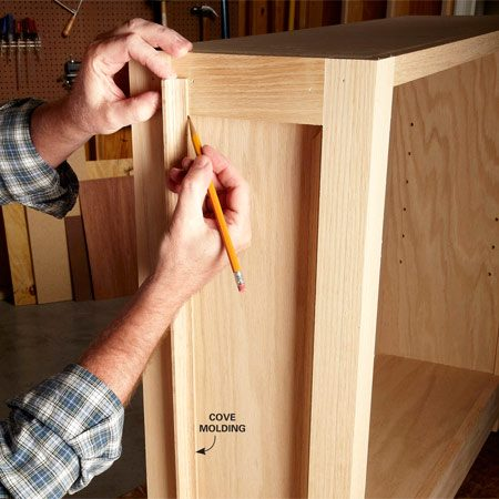 <b>Photo 6: Classic style, the simple way</b></br> <p>Common cove molding gives the sides a classic  frame-and-panel look. Miter one end of each piece and hold it in place to mark it. Cut the piece a hair long and test the fit. If it's too long, take it back to the miter saw and shave off a smidgen.</p>