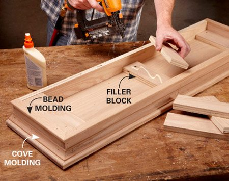 <b>Photo 11: Simple moldings for a fancy top</b></br> <p>Trim the frame with cove molding and homemade bead molding. Then glue in two layers of plywood filler blocks. The blocks allow the top to be screwed to the shelf box.</p>