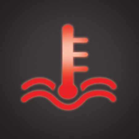 <b>Hot light</b></br> The hot light indicates engine overheating. Pull over in a safe spot and call for service.