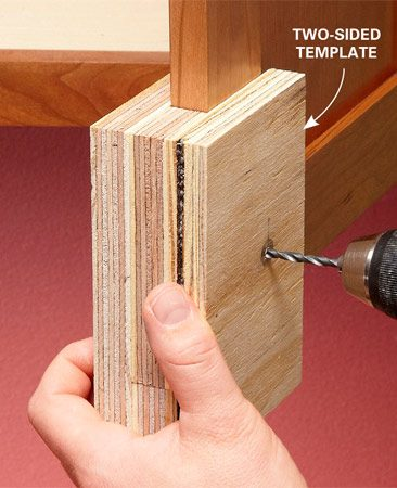 <b>Drill cleaner holes</b><br/>If you're having problems with the wood on the back side of the cabinet doors tearing out every time you drill a hole, make a two-sided template. Make sure the spacer wood is close to the same size as the cabinet doors. The tighter the fit, the less chance of tear-out.