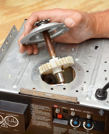 <b>Photo 1: Pull out the old gear</b></br> The shaft, sprocket and main drive gear should all come out as one piece. This procedure is best performed on a benchtop.