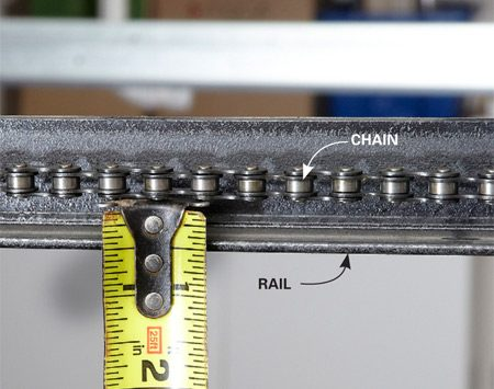 <b>Measure the slack on the chain</b><br/>Check for proper chain tension by measuring the distance between the chain and the rail at a point close to the center of the rail.