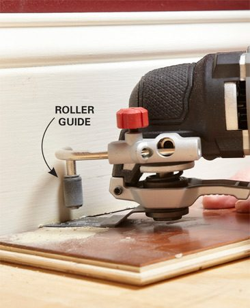<b>Look for useful features</b></br> Porter-Cable's PCE605 has a unique roller guide that can limit the depth of cut or simply help to steady the tool. It's removable and you'll probably want it out of the way most of the time. But we found it a big help for some jobs: When removing grout, we cut perfect, consistent lines without stopping to check the depth. (We wrapped the roller with electrical tape to avoid marring the tile.) When undercutting the baseboard shown here, we avoided cutting into the blade-wrecking plaster behind the baseboard.