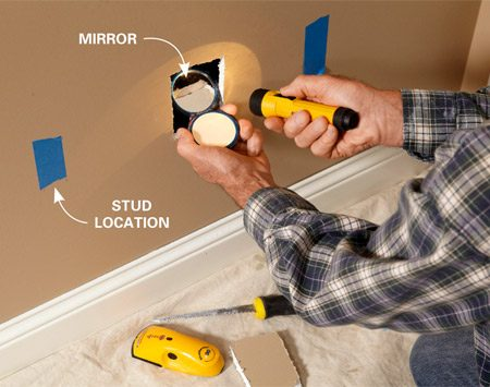 <b>Photo 1: Before you cut the big hole…</b></br> Cut a small inspection hole and use a compact mirror and flashlight to peek inside the wall. Look for pipes, wires or other obstructions.