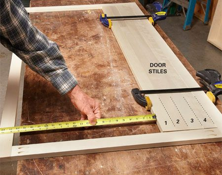 <b>Photo 3: Measure for the door rails</b></br> Cut the four door stiles and stack them inside the face frame. Measure the remaining space and subtract 3/8 in. to determine the length of the door rails.