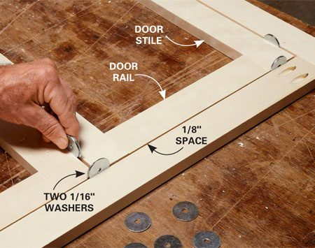 <b>Photo 4: Check the fit before you assemble the doors</b></br> Arrange the door parts inside the face frame and wedge them with pairs of 1/16-in.-thick washers. Adjust the lengths if needed. When the fit is good, remove the parts and assemble the doors with pocket screws.