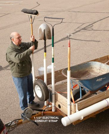 <b>The landscaper's trick</b></br> Landscapers and lawn care guys always haul around rakes, shovels, brooms and other implements by mounting vertical tubes on the front of their trailers. Here's our version. Cut 36-in. lengths of 1-1/2-in. PVC pipe and glue on an end cap. Then drill a hole in each end cap to provide drainage. Attach the tubes using PVC electrical conduit straps and nuts. If you plan to use the tubes in winter, secure them with metal straps—PVC gets brittle in cold weather and can shatter. For added security, hook a bungee strap to each implement.