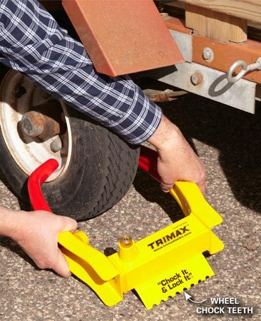 """<b>More security</b></br> <p>If you have a really expensive  trailer, it pays to   get an extra layer of protection  by using a   """"boot""""-style lock in addition to  the coupler lock.   There are many styles to choose  from, but we liked   this particular model (the Trimax  TCL75 Wheel   Chock Lock; sold at <a href='http://www.newegg.com' target='_blank' rel='nofollow'>newegg.com</a>) because it   doubles as a wheel chock to  prevent the trailer   from rolling. Just slide it onto  the wheel and press in the lock cylinder.</p>"""