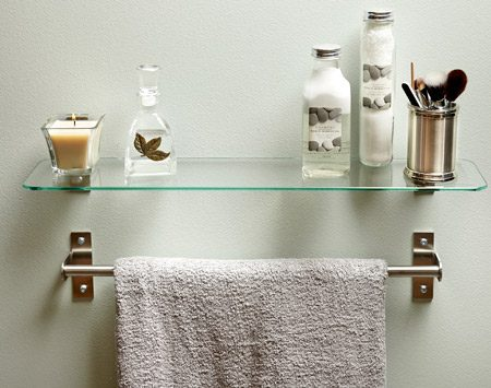 <b>Hang a shelf</b><br/>Just make sure it doesn't interfere with the towel rack.