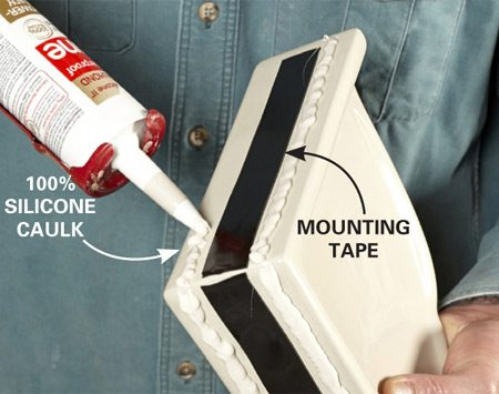 <b>Step 1: Prepare the shelf</b><br/>Apply a strip of double-face adhesive mounting tape on each flange, stopping 1 in. short of the outside ends. Then lay a thick bead of silicone caulk around the entire perimeter.