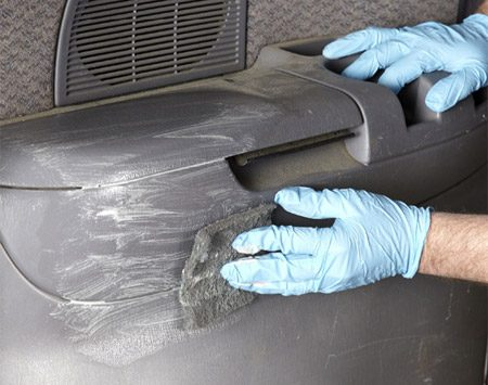 <b>Photo 1: Soap and scrub</b></br> Apply SEM Soap to vinyl and plastic surfaces and scrub with a scuff pad. Put extra effort into textured and recessed areas. Wipe the surface with a clean, damp, lint-free cloth and let dry.