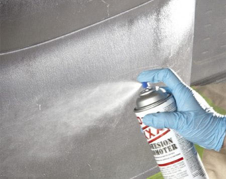 "<b>Photo 2: Spray and wipe</b></br> Spray Vinyl Prep on vinyl areas and wipe off the residue in one direction with a clean, damp, lint-free rag. Then spray Adhesion Promoter on plastic surfaces and let it ""flash."" Wipe off with a clean cloth. Let dry."