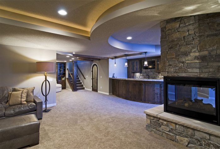 Think outside the box. Use curves and <br> warm colors to create a &ldquo;great room.&rdquo;<br/>Image provided by Finished Basement Company
