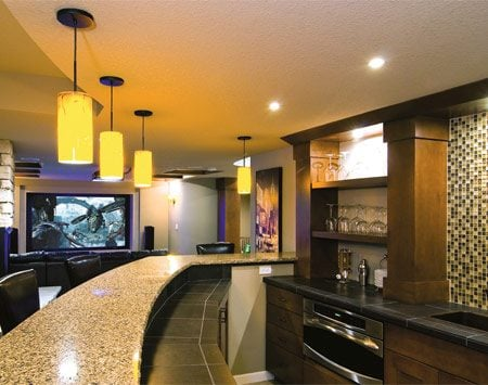 <b>Vary your lighting choices</b><br/>Recessed cans, hanging fixtures, floor lamps or whatever else, different situations call for different solutions.<br/>Photo provided by Finished Basement Company