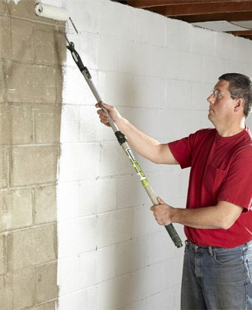 <b>Roll on the sealer</b></br> Use a paint roller to apply the waterproofing product you choose.