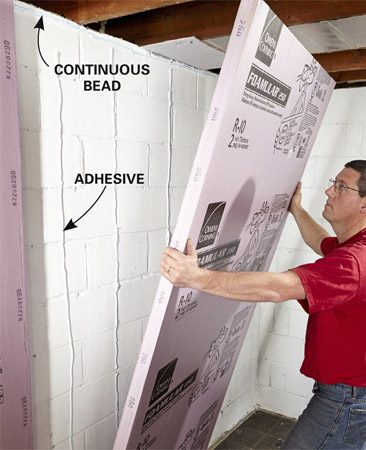 <b>Install the foam sheets</b></br> Apply the adhesive vertically to keep water from pooling behind the foam insulation.