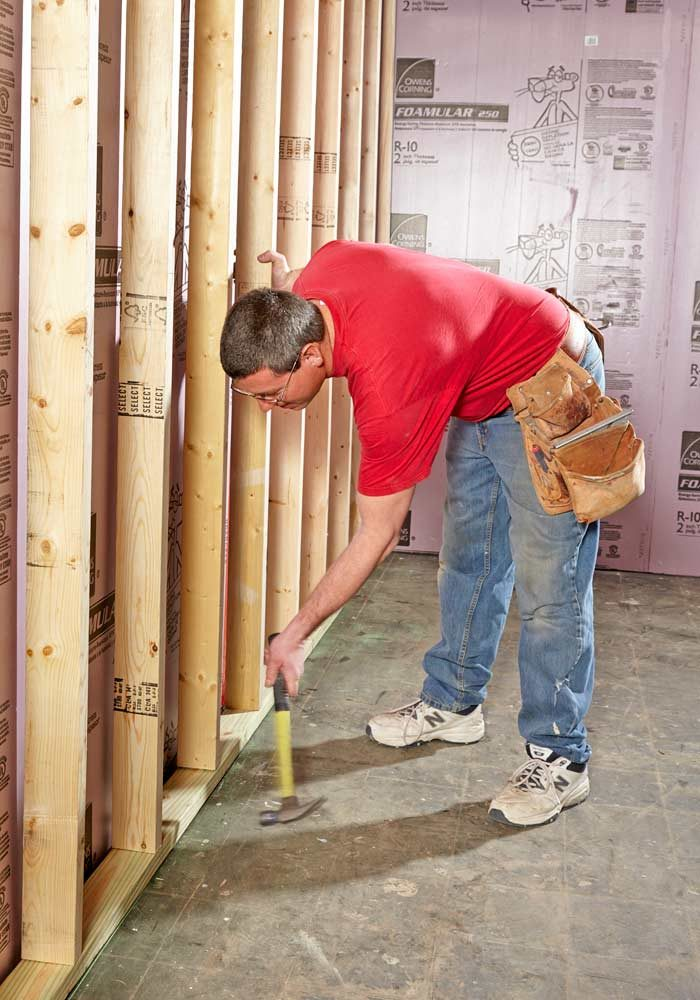Measure the distance from the floor to the<br/> joists at several locations and<br/> build your wall at least 1/4 in. shorter<br/> than the shortest measurement.