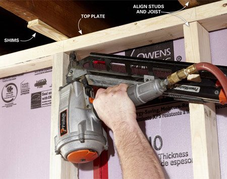 <b>Plumb the wall and secure the top plate</b></br> Plumb the wall about every 4 ft. You need shims only about every third joist, but nail the top plate to every joist.