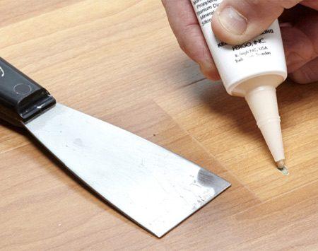 Photo 1: Work the filler until it stiffens, then apply.