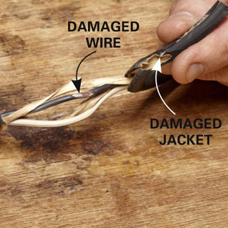 <b>Photo 1: Slit and peel the jacket</b></br> Slice around the outer jacket about 3 in. on both sides of the damage. Then slit the jacket down the center and peel it off.