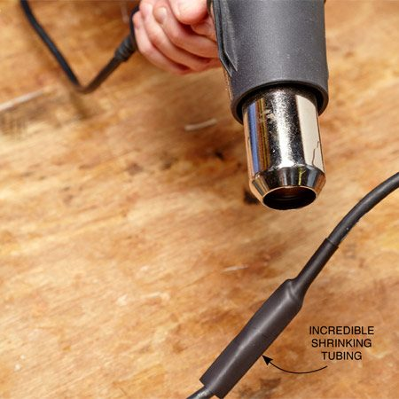 <b>Photo 3: Cover and shrink</b></br> Slide the shrinkable tubing over the splices and outer jacket. Shrink the tubing with a heat gun.