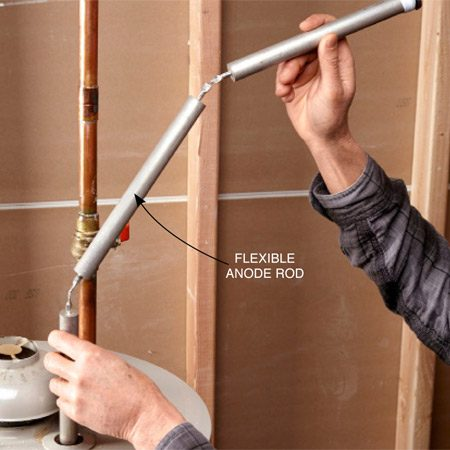 <b>Photo 2: Install the new anode rod</b><br/>Coat the threads with pipe dope and slide the new rod into the tank. Tighten with a socket and ratchet by hand.