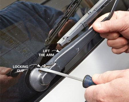 <b>Photo 3: Other wipers have a locking clip</b></br> Lift the wiper arm a few inches off the glass and slide the locking clip out. Then lower the arm and pull it off the splined shaft.