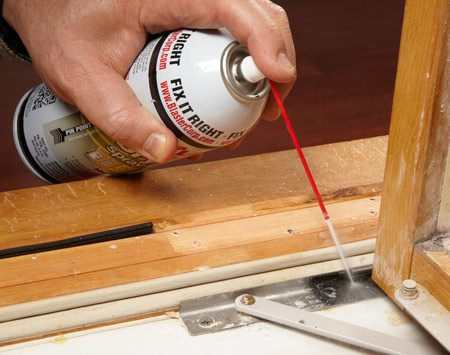 <b>Photo 3: Lubricate the hinges</b></br> Saturate each hinge with silicone or dry Teflon spray lube. Wipe up the excess. Then work in the lube by opening and closing the window several times.