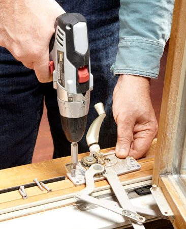 <b>Photo 5: Remove the operator trim</b></br> Slide a flat bar under the sill operator trim piece and gently pry it up slightly on one end. Then move the flat bar to the opposite side and pry that up (see lead photo). Next, remove the operator screws and the operator.