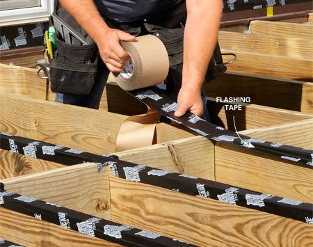 Apply flashing tape to joist tops